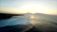 Beautiful drone shot reveal of Maui coastline as the sun is setting