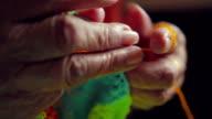 beautiful elder hands knitting close up