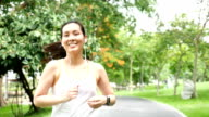 Beautiful Female Athletic Running in the park Slow Motion