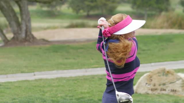 Beautiful Female Professional Golfer Plays Golf