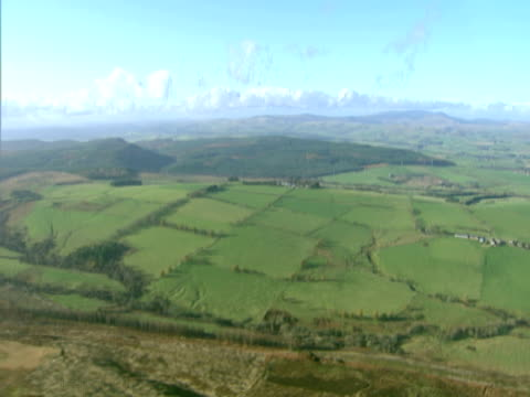 Beautiful fields and hills in sunlight aerial view. PAL, NTSC