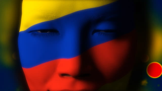 Beautiful girl COLOMBIAN flag face painted