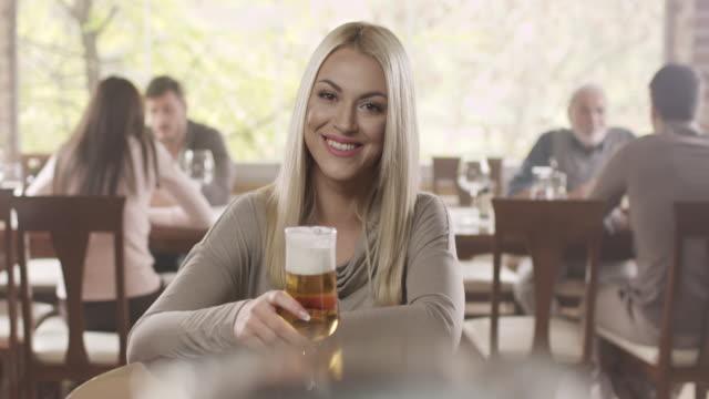 Beautiful girl drinking beer