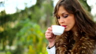 Beautiful Girl enjoy a coffee in Nature