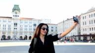 Beautiful girl taking a selfie in Trieste ,Italy