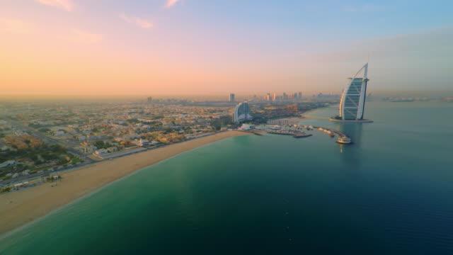 AERIAL Beautiful Jumeirah beach at dusk
