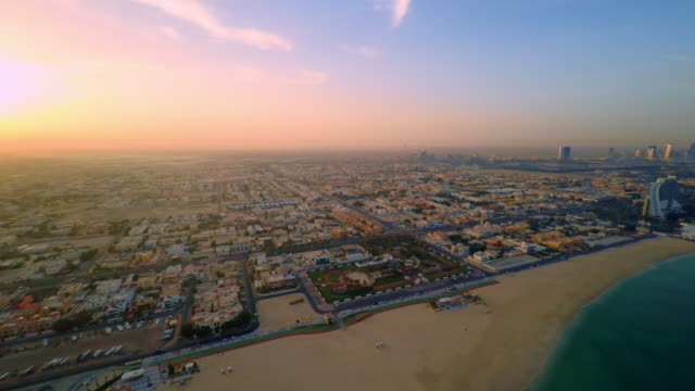 AERIAL Beautiful Jumeirah beach at sunset