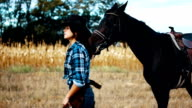 Beautiful lady with her black horse