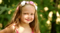 Beautiful little girl with floral headband
