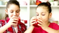 Beautiful Little Girls Drinking A Strawberry Smoothie
