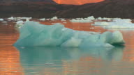 Beautiful midnight sun with blue icebergs in Greenland