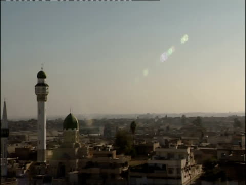 Beautiful minarets dominate the skyline of Mosul, Iraq.