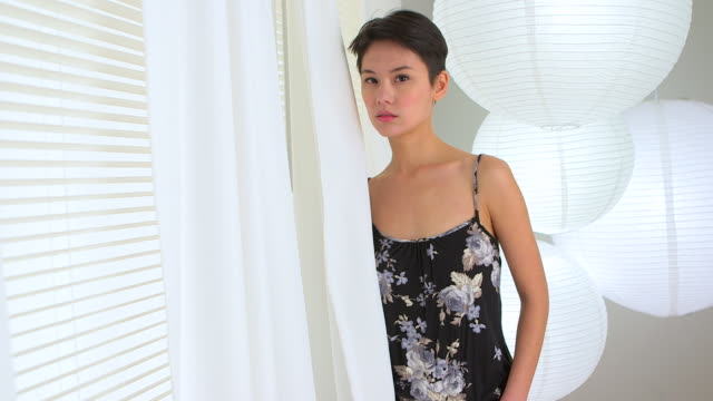 Beautiful Mixed race Asian woman standing in living room