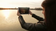 Beautiful scene with a young adult using digital tablet.