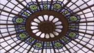A beautiful stained glass skylight is situated in the ceiling of the Senate Chamber in the Romanian Palace of Parliament. Available in HD