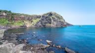 beautiful stone beach in cheju island in blue sky. timelapse 4k
