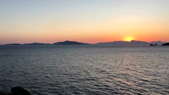 A beautiful sunset can be seen at the bay off the Bodrum Peninsula on September 17 2017 in Bodrum Turkey Bodrum and the Bodrum Peninsula famous for...