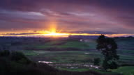 Beautiful Sunset Over Steaming Geothermal New Zealand Landscape - Time Lapse