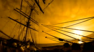 beautiful sunset through the rigging of a sailing ship