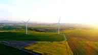 Beautiful view of windmill turbine at sunset. Renewal Energy.
