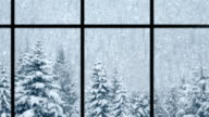 Beautiful winter scene of snow falling over pines, loopable