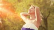 Beautiful woman basks in the sun