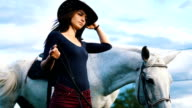 Beautiful woman enjoy time with her white horse