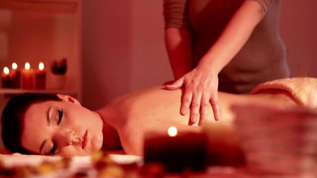 Beautiful woman enjoying massage treatment