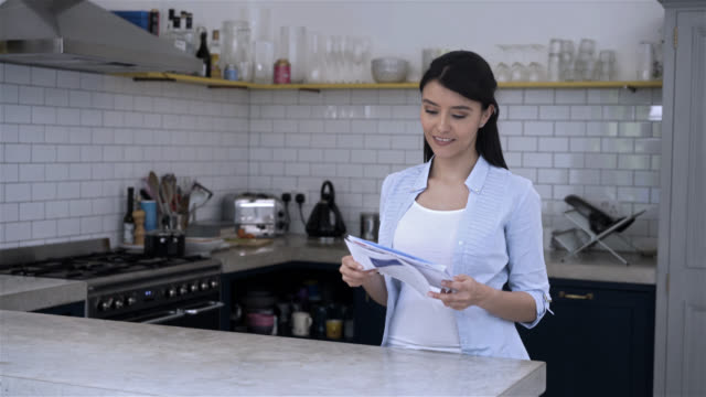 Beautiful woman going through her mail