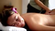 Beautiful woman having relaxing in spa massage salon.
