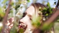 Beautiful woman in orchard.