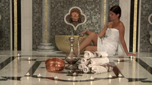 Beautiful Woman in Roman Bath