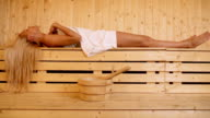 Beautiful woman in sauna