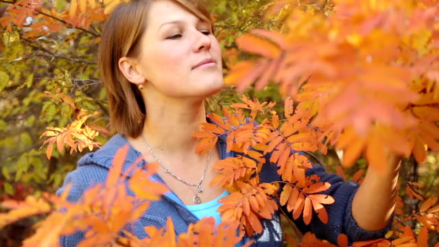 beautiful woman in the autumn forest