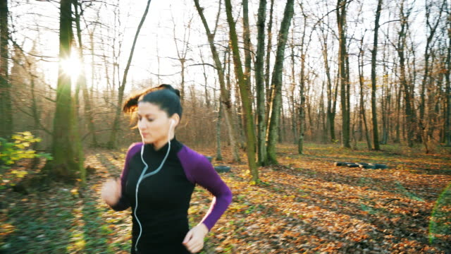 Beautiful woman running in the forest.