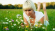 HD DOLLY: Beautiful Woman Smelling Daisies