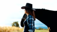 Beautiful woman take a walk with horse