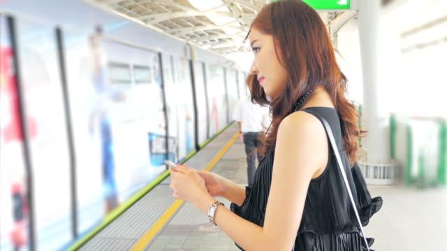 Beautiful woman waiting The train