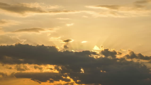 Beautiful yellow cloudscape with sunlight beams