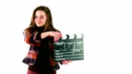 Beautiful young girl clapping with film slate or claperboard