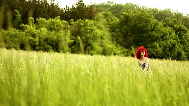 Beautiful Young Red hair Woman having Fun in the Meadow