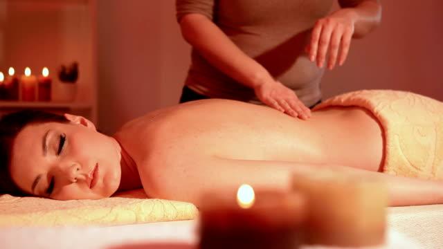 Beautiful young woman enjoying massage dolly shot