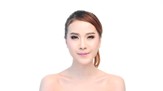 Beautiful young woman face close up