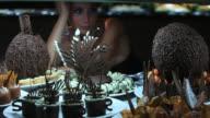 Beautiful young woman looks at chocolate buffet