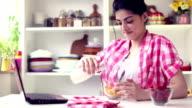 Beautiful Young Woman Preparing Healthy Breakfast