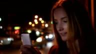 Beautiful young woman, urban smartphone.
