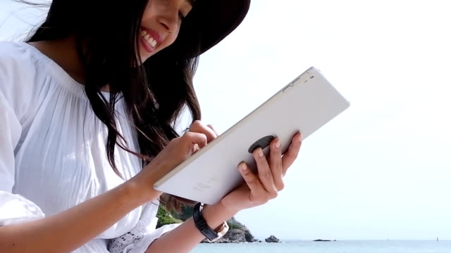 Beautiful Young Woman Using Digital Tablet Touch Screen