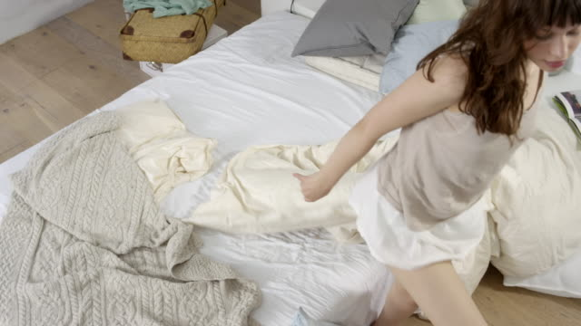 beautiful young woman - wakes up and leaves her bed