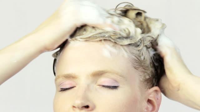 Beautiful Young Women Washing Her Har.