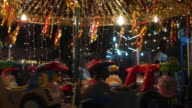 A beautifully illuminated merry-go-around at a traditional travelling carnival in New Delhi
